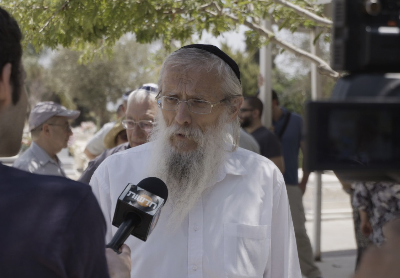 Yosef interviewed channel 10 at Marks funeral 2015