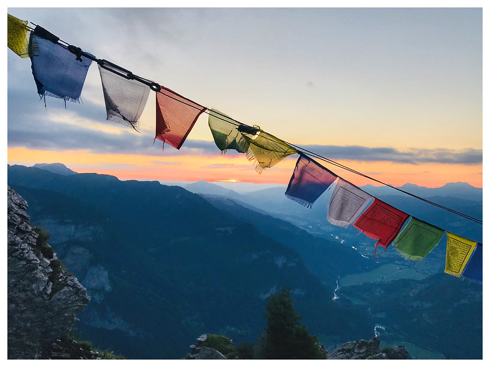 Sunset and prayer flags at the Refuge du Grenairon