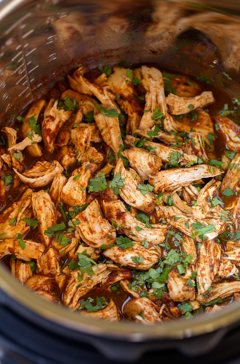 Salsa Chicken simmering in instant pot or slow cooker.
