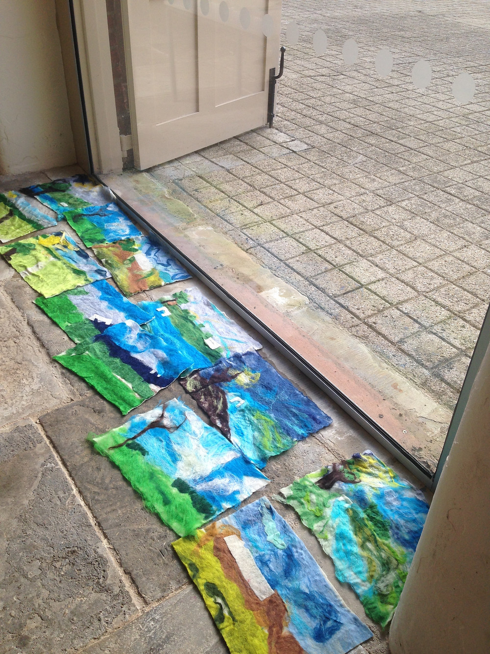 Felts drying in the court yard windows