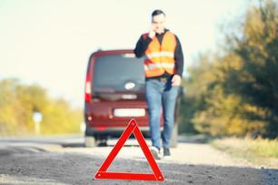 bigstock-Red-warning-triangle-on-asphal-169817588.jpg
