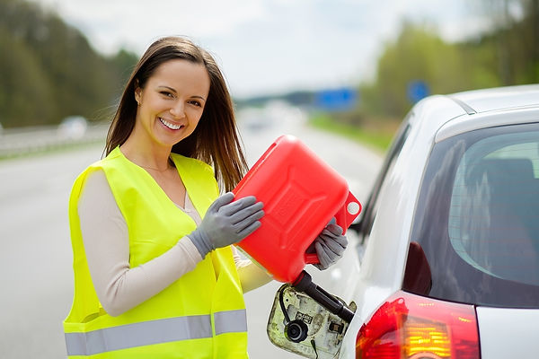 bigstock-Woman-refuelling-her-car-on-a--