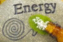 homeopathic globules on stone of energy.