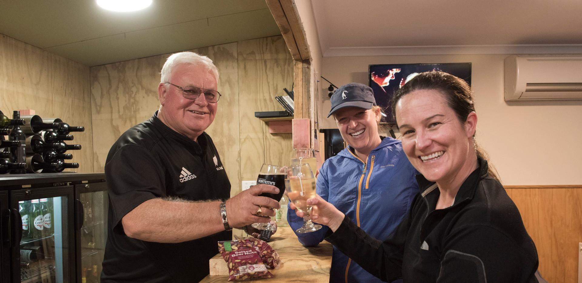 Dutchy serves drinks at the Adventure Lodge bar