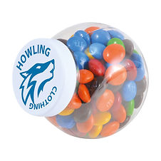 145 grams of assorted colour milk chocolate M&M's (Green, Red, Orange, Yellow, Brown and Blue) packed in clear container with white screw cap lid and tamper evident security seal.