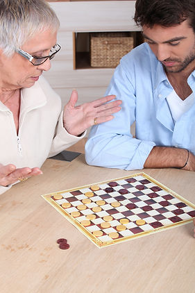 Senior-woman-playing-chess-with-carer