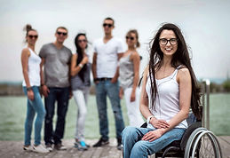 Girl in wheelchair with friends
