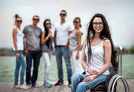 Girl-in-wheelchair-with-friends.jpg