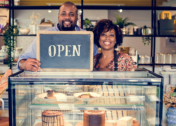 Cake cafe owners with open sign.jpg