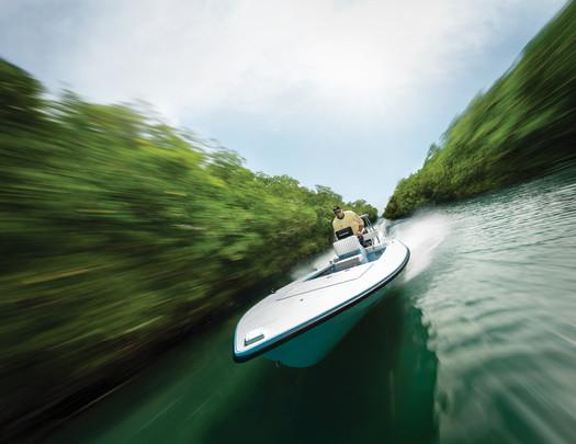 Flats Boat Running a Mangrove Ditch