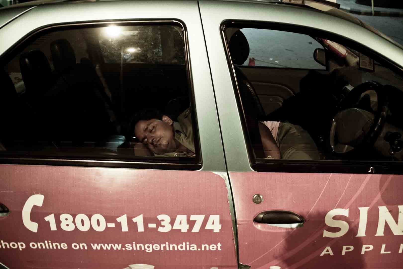 A taxi-driver catches some sleep