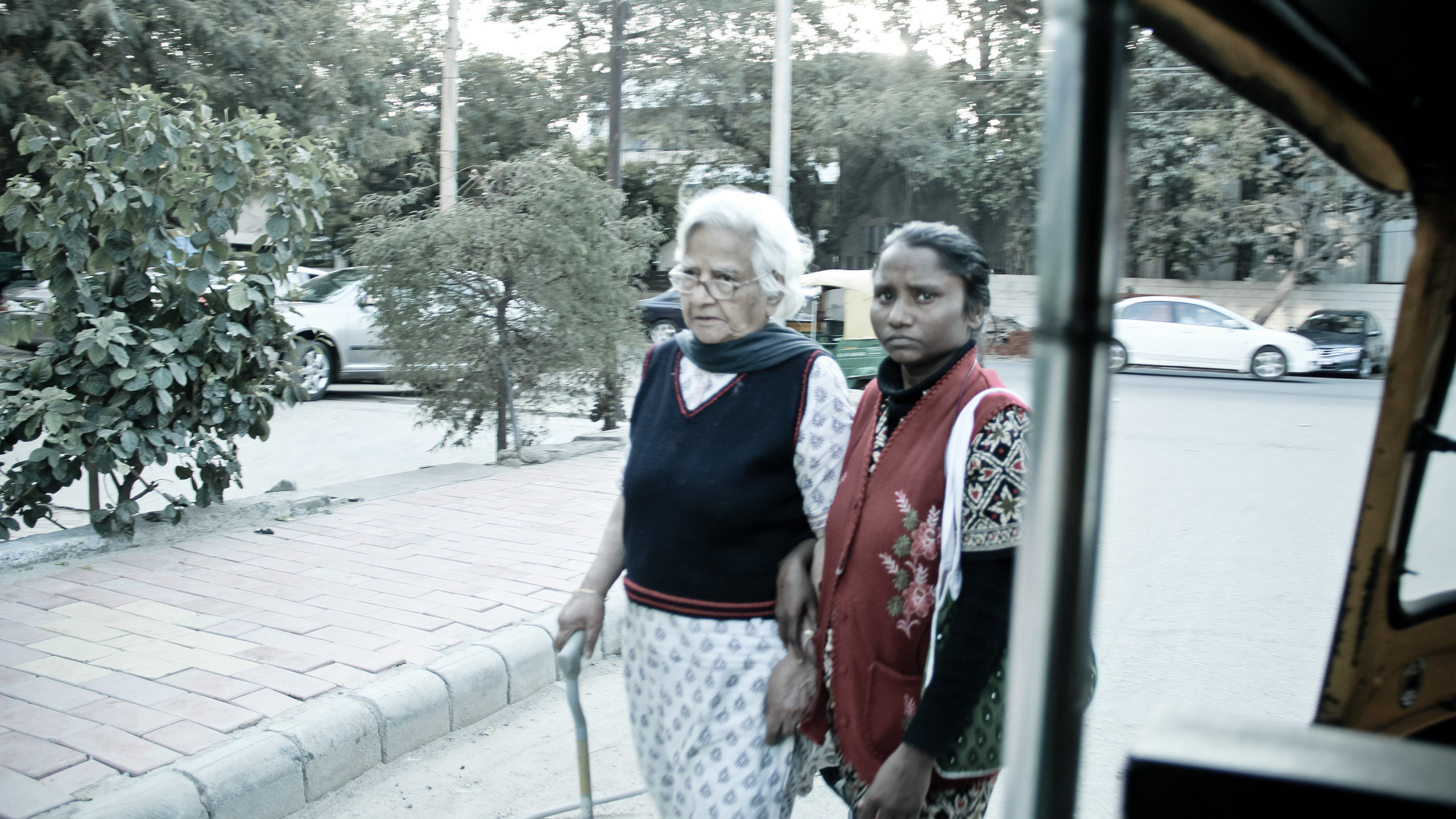 Sunita accompanies the oldest citizen of her family she works and lives with, for her evening walk