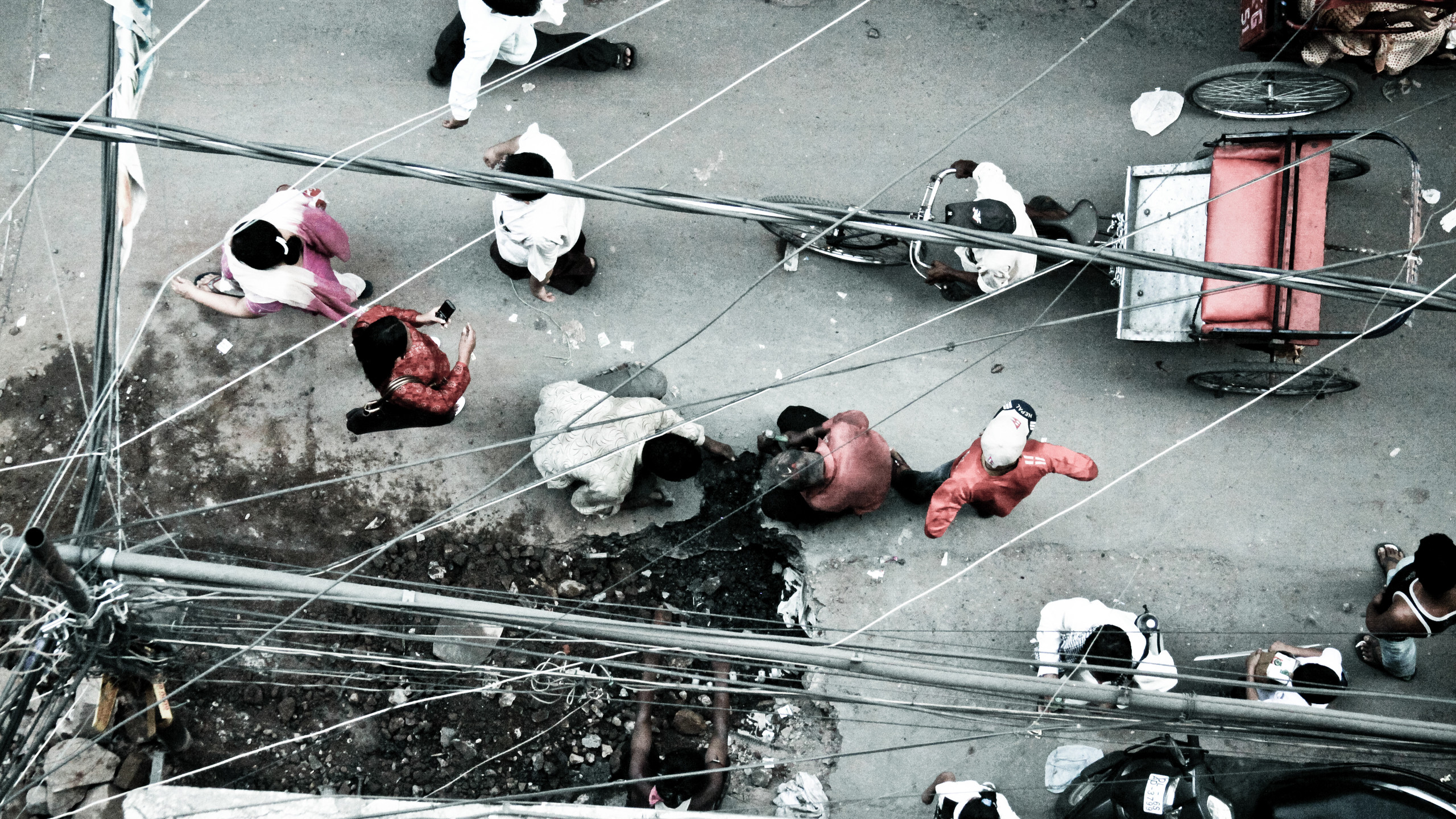 Daily wage labourers laying pipelines in congested Paharganj, a tourists' hub near the railway station in North Delhi