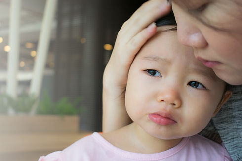 Mother soothing crying little girl..jpg