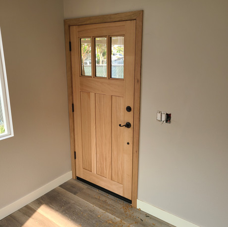 Craftsman style front door. Unfinished.
