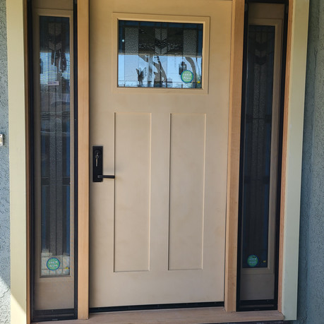 Craftsman style front door with two sidelights