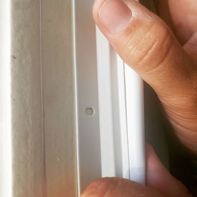 Installation of weatherstripping on door jamb - white
