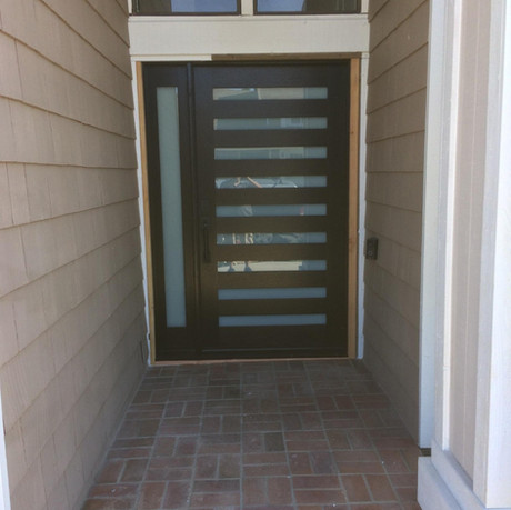 Modern door with glass slats and sidelight