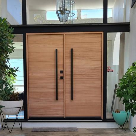 Modern wood door with black hardware