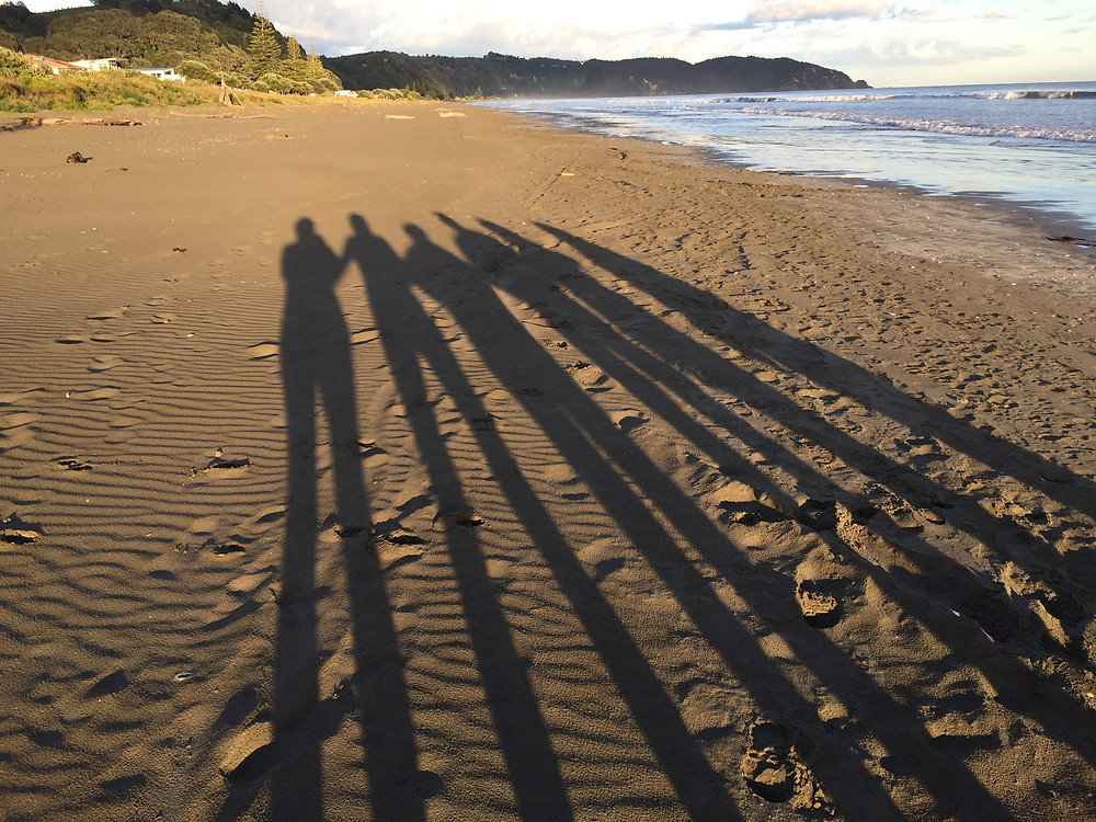 Return to Love NZ - Blog - Are we all Kiwis at heart?Shadows of people in the sand