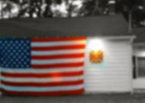 Flag hung on the front of Muddy Brook Fire Department