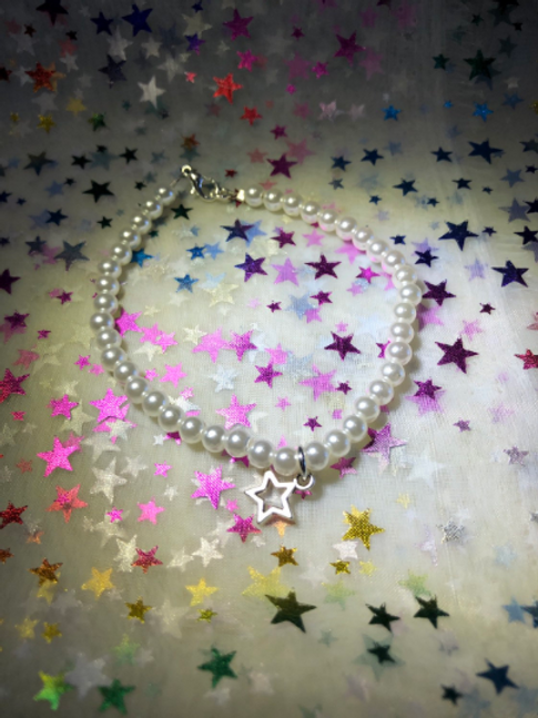 Imitation pearl bracelet with charms