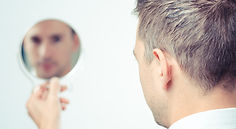 ego man reflection in mirror on a white