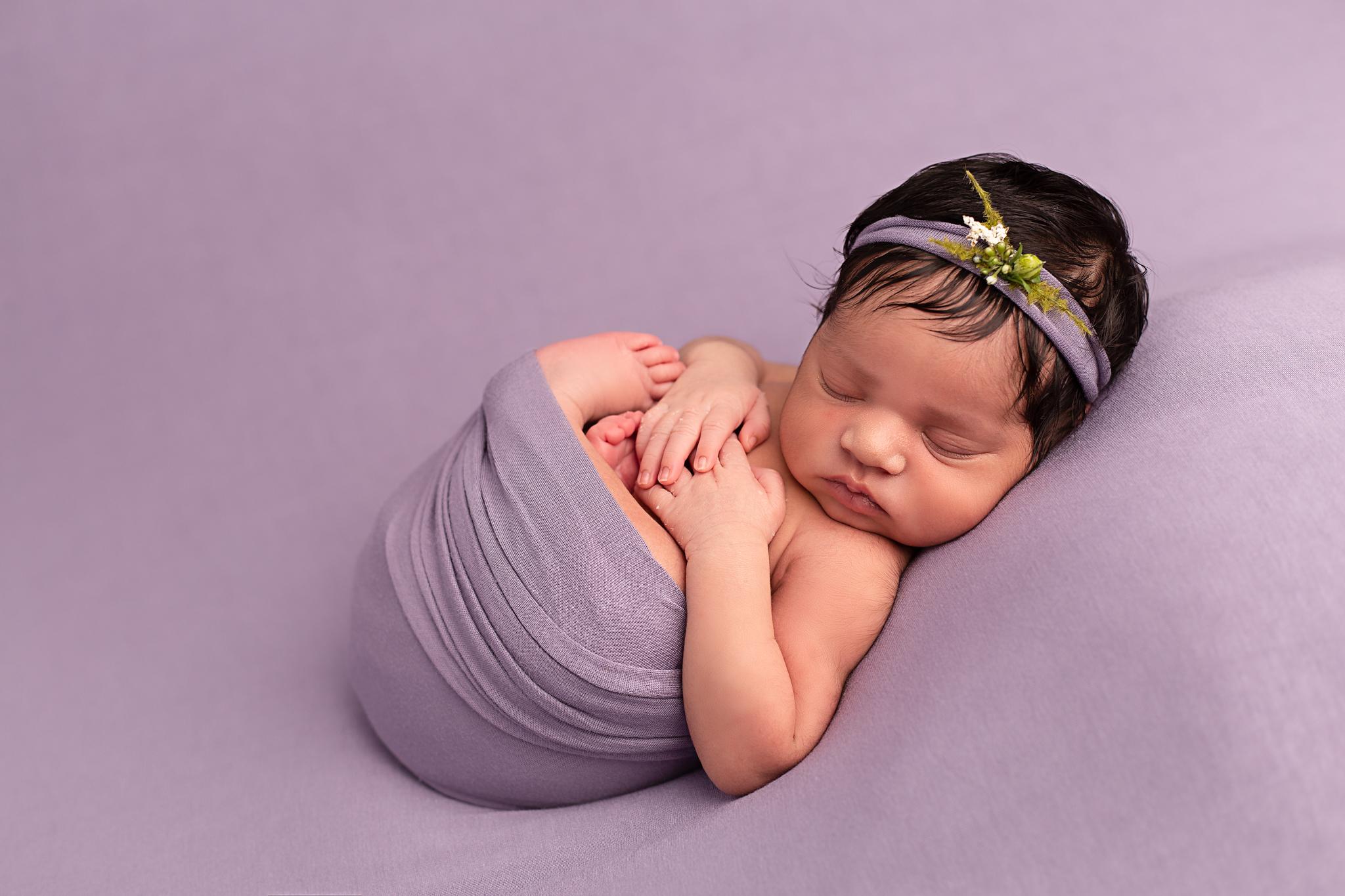 newborn photo on purple