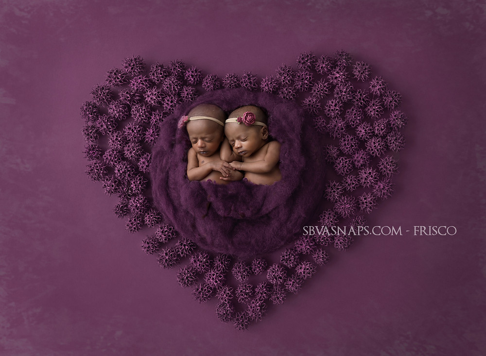 Twin newborn girls