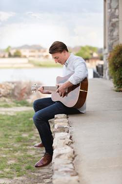 senior boy playing guitar
