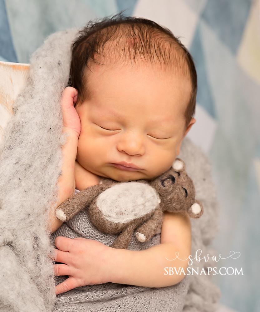 newborn boy with felted bear