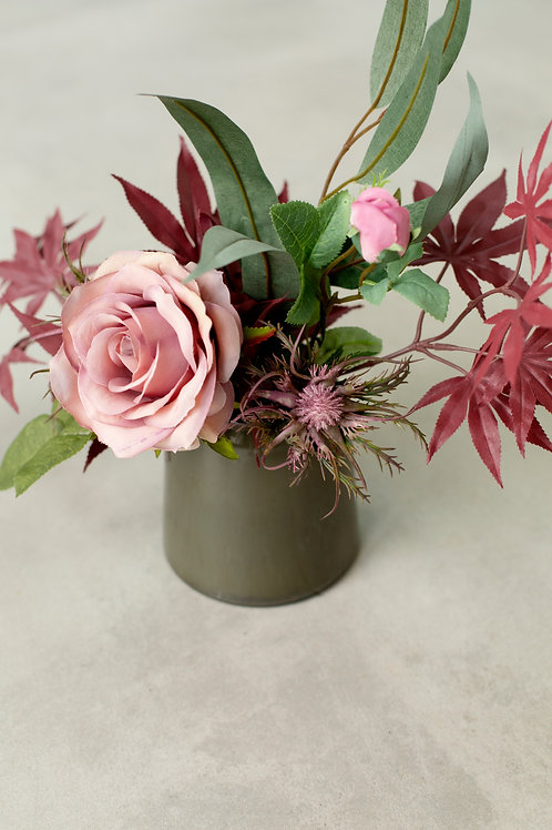 Faux roses in glass vase