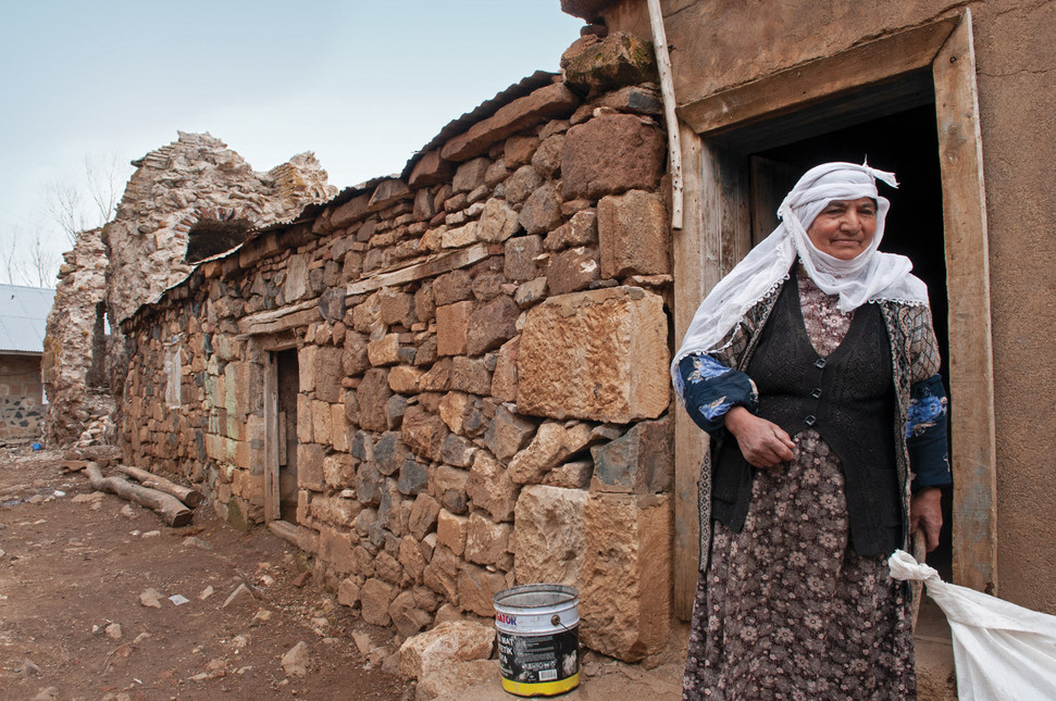 A Kurdish woman lives in a structure built from stones of the Armenian monastery of Saint Garabed, in the Mush region the Armenian Highland.