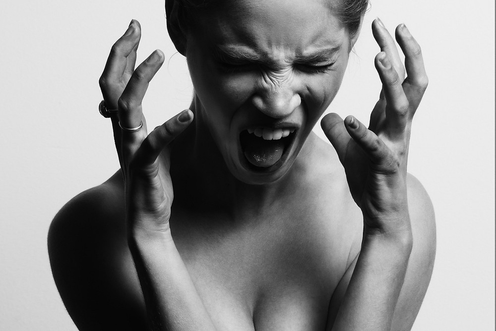Woman screaming because of a bad day or a wasted day.