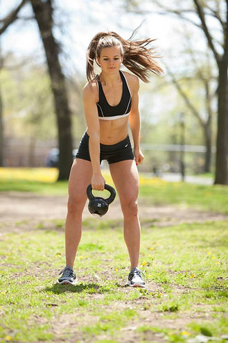 katie mack fitness personal trainer portrait with kettlebell