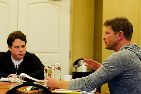 Actors Burgess Jenkins and Jimmy Bellinger with director Zach Meiners in a pre production meeting.