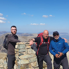 On top of Scafell Pike with a group