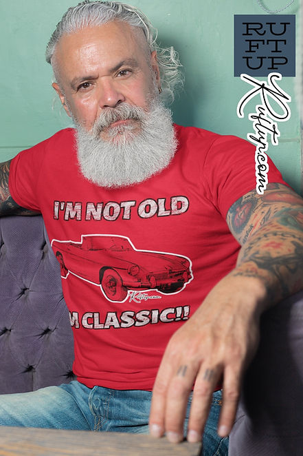 Im-Not-Old-Im-Classic-t-shirt-mockup-featuring-a-man-sitting-on-a-purple-sofa