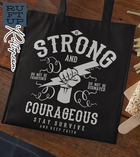 Be-Strong-and-Courageous-grocery-bag-mockup-against-a-wooden-table