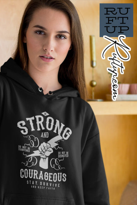 A pretty young girl wearing a black pullover hoodies with the design Be Strong and Courageous Ruftup Design on the front