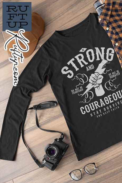 Mockup display photographed for th Long sleeved tee in black with te Be Strong and Courageous message design release by Ruftup Designs