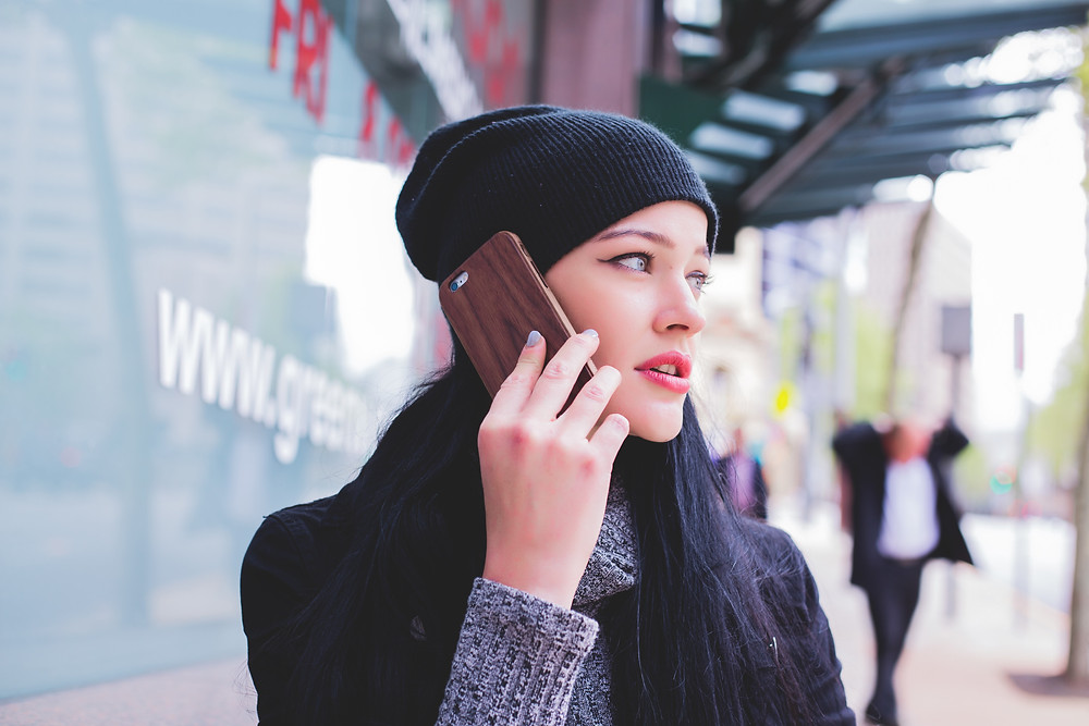 A traveling woman calling and talking on phone