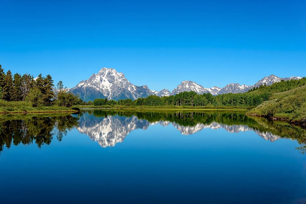 A lake reflecting mountains