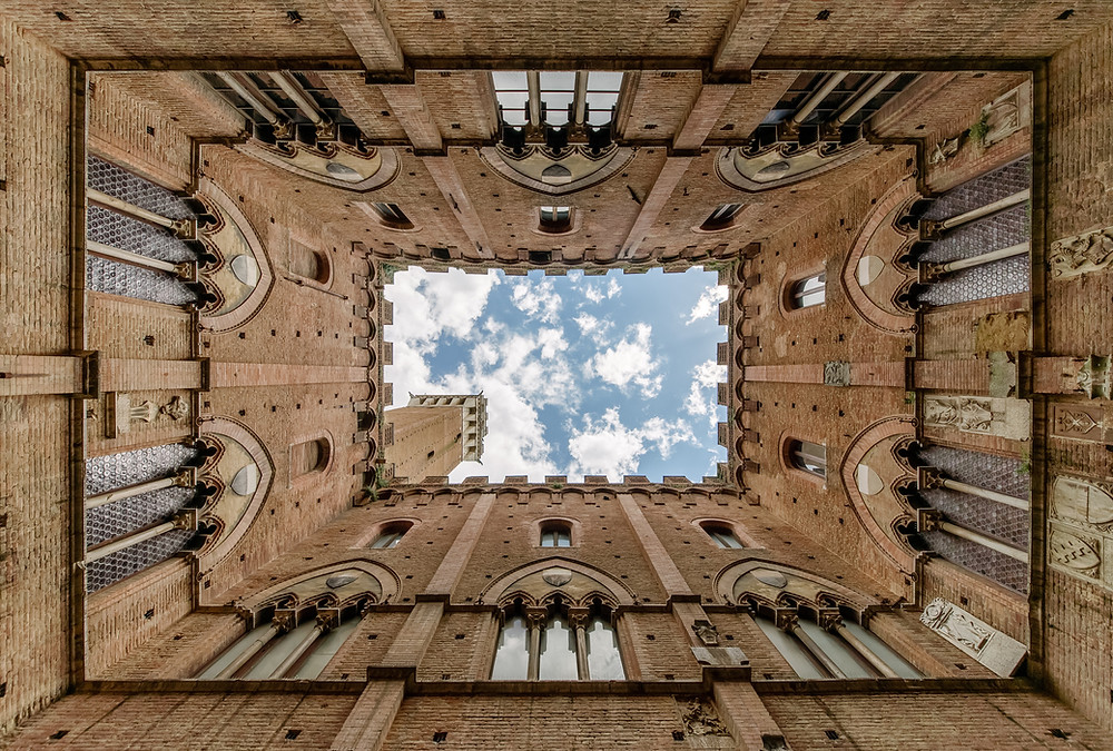 A view of the sky from inside a tower