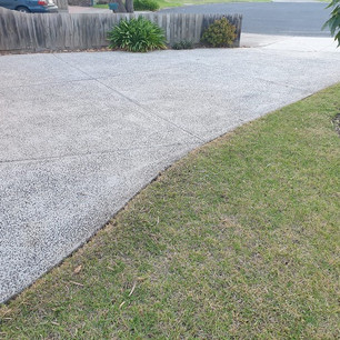 Concrete driveway after our high pressure cleaning service.
