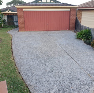 Decorative concrete driveway in Melbourne after  high pressure washing.