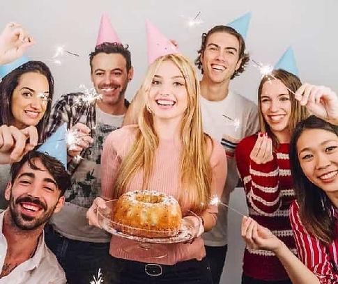 sharing birthday cake at birthday party venue