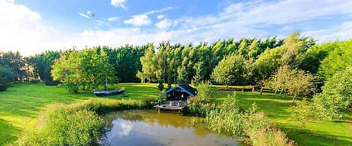 Outdoor venue for hire - The lake and boathouse at Crown Hall Farm