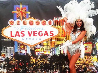 Showgirl against themed panel at Vegas themed wedding