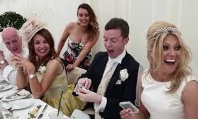 Wedding entertainment at Crown Hall Farm - table magician entertaining the bride, groom and thier guests